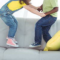 Kids jumping on sofa