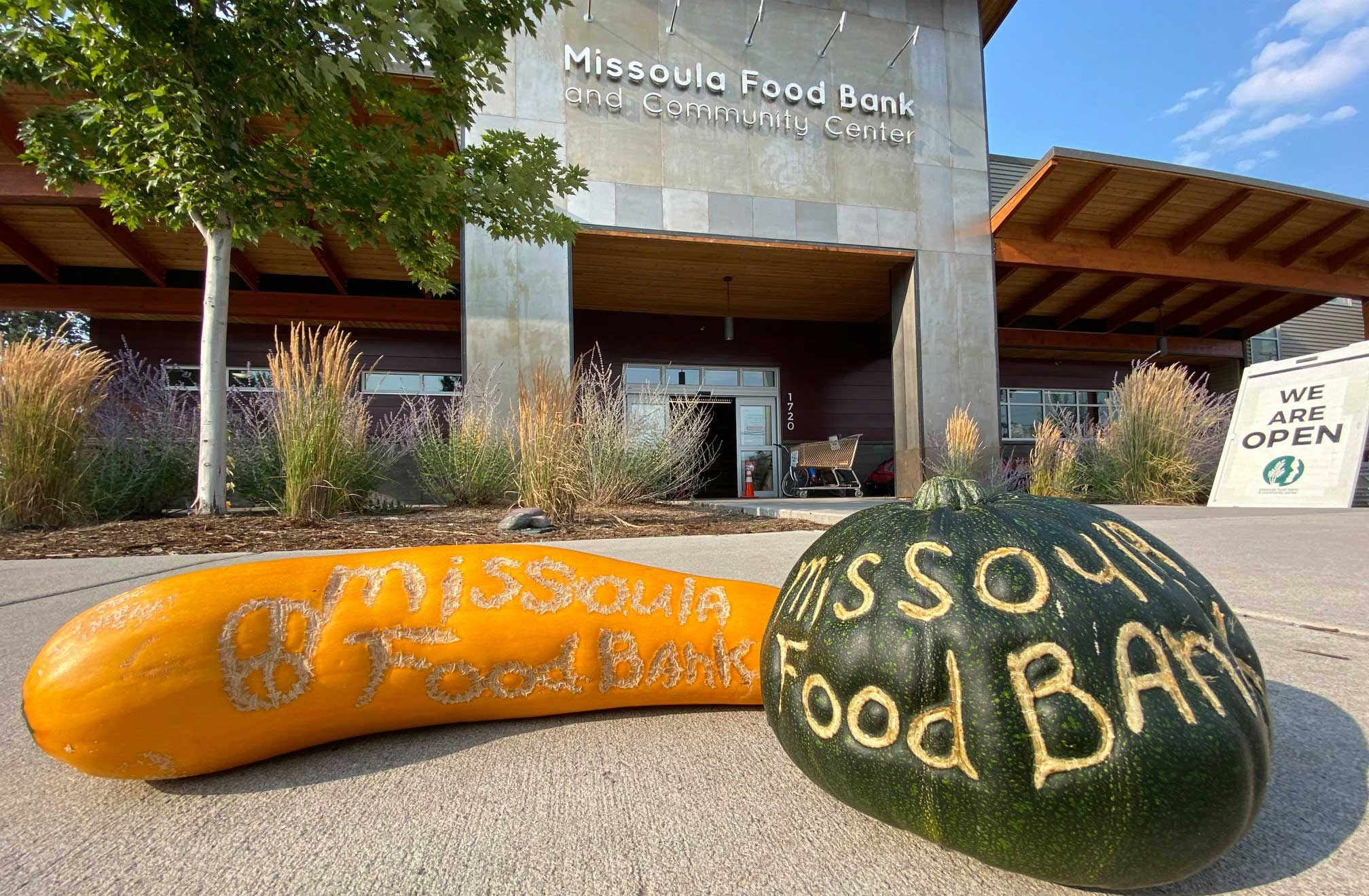 Gourds with 'Missoula Food Bank' carved into them sitting in front of the Missoula Food Bank.