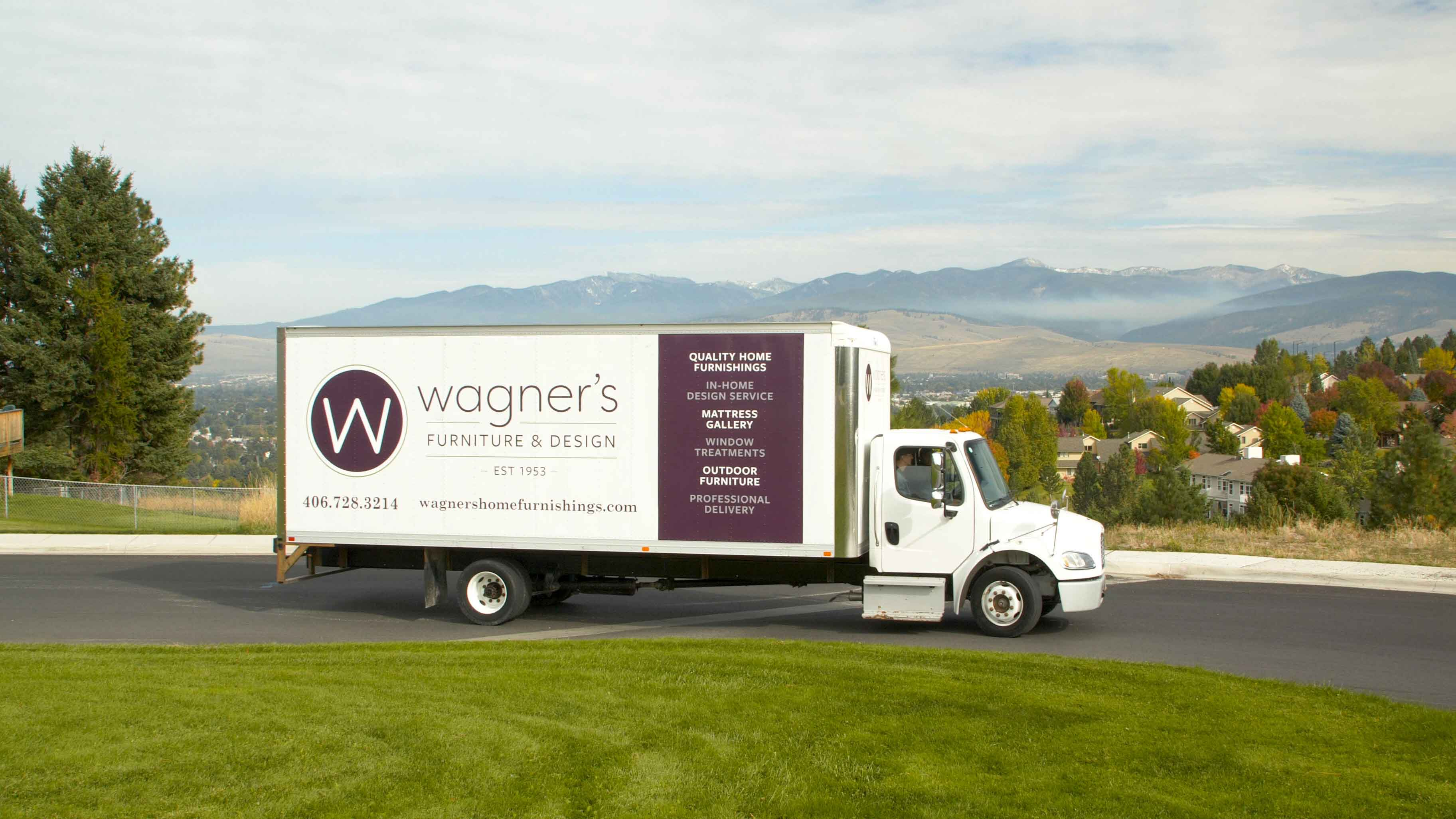 Wagner's delivery truck parked in front of scenic overlook