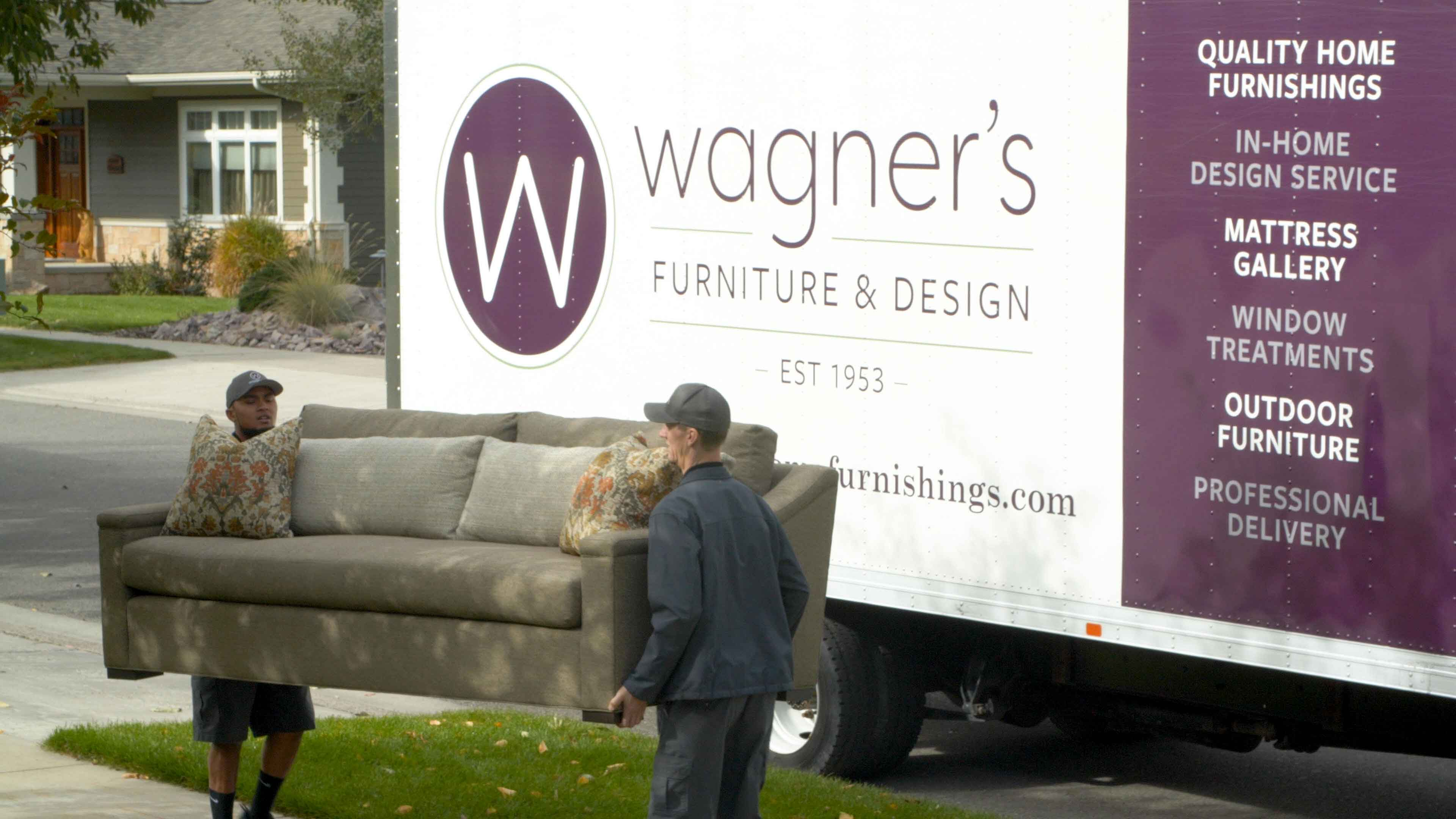 Wagner's delivery truck being unloaded